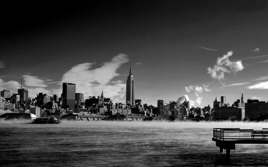 This photo was taken on a very cold morning from Hoboken.  There was a very sharp drop in temperature from the night before which resulted in the smoke coming off the river.